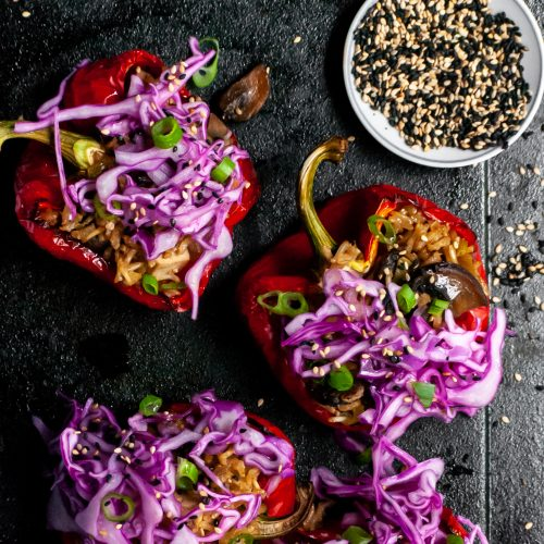 Roasted Peppers Stuffed with Sesame Ginger Mushrooms, Tofu and Rice, Topped with Red Cabbage Slaw