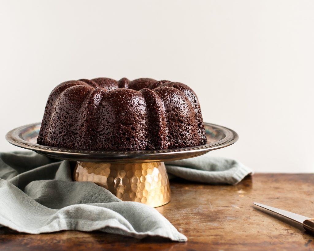 Vegan Chocolate Bundt Cake just before peanut butter glaze is poured over
