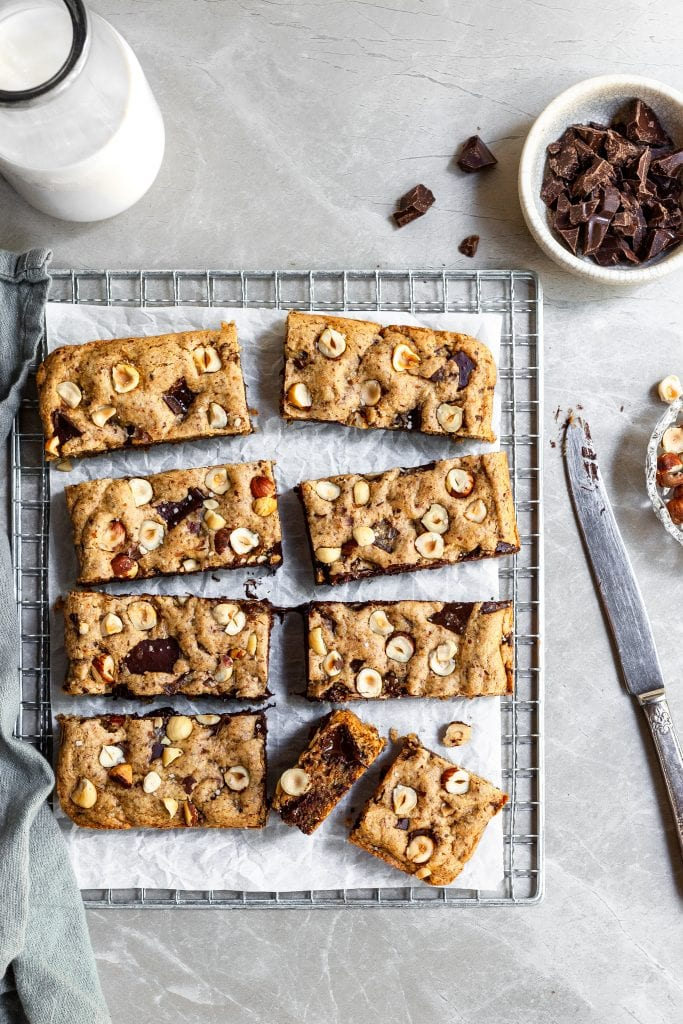 Chocolate Chunk Blondies cut into 7 rectangles and 2 squares on a cooling rack