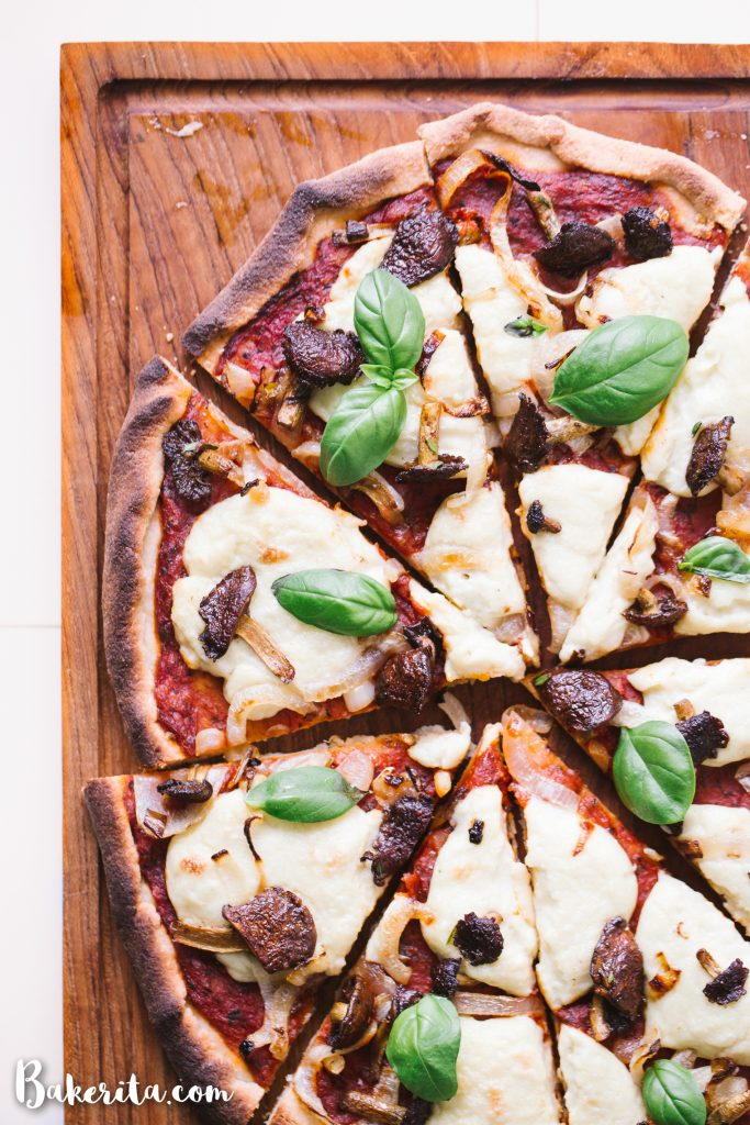 vegan gluten free pizza topped with mushrooms and onions