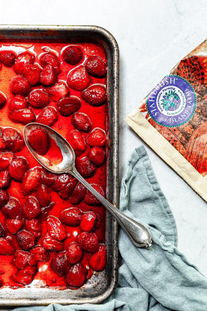 A baking sheet covered in roasted strawberries