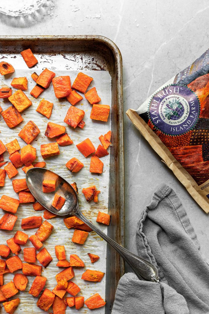 Baking sheet filled with roasted sweet potatoes