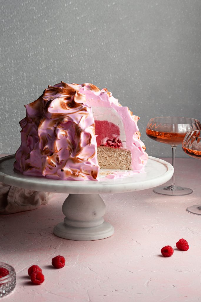 Pink baked alaska with a pink and white ice cream filling
