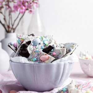 A white bowl filled chocolate candy Easter bark