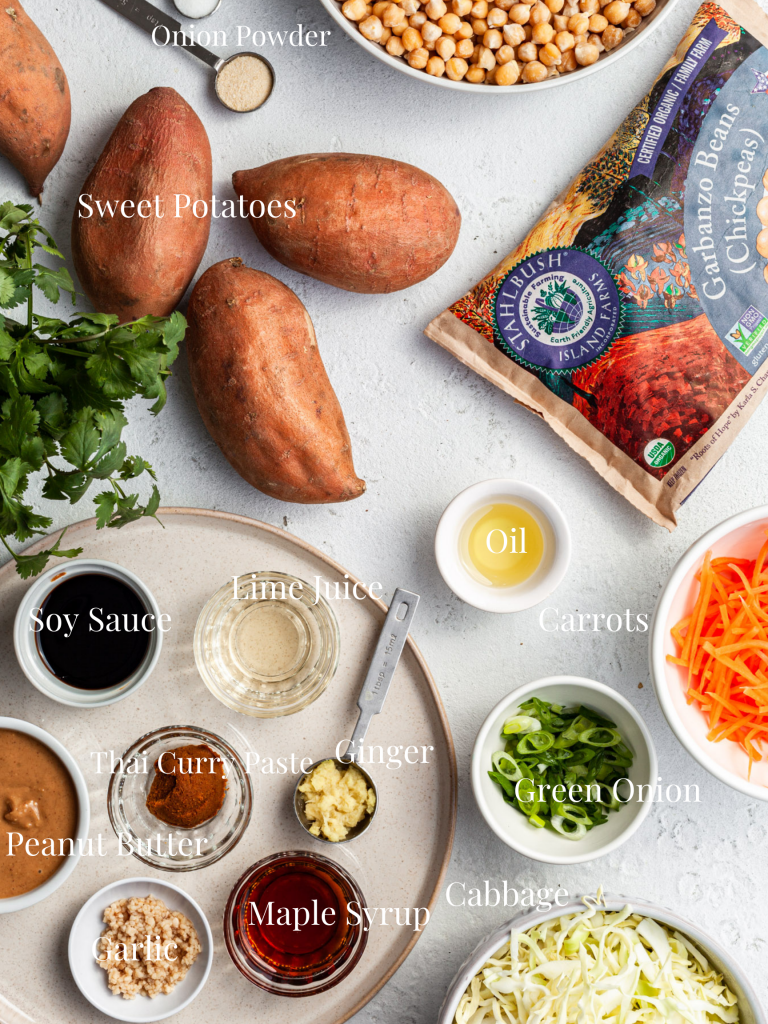 View looking down on a white counter filled with the ingredients labelled for this Thai peanut stuffed sweet potato recipe.