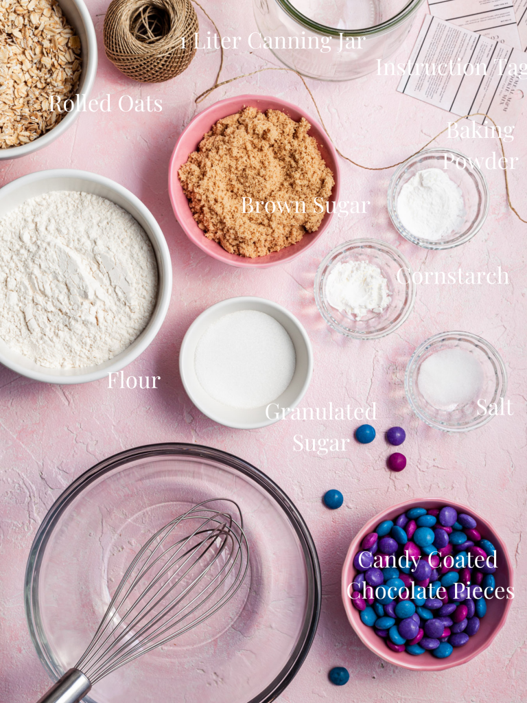 An image labelled with the ingredients, equipment and supplies needed to make cookie kit jar gifts.