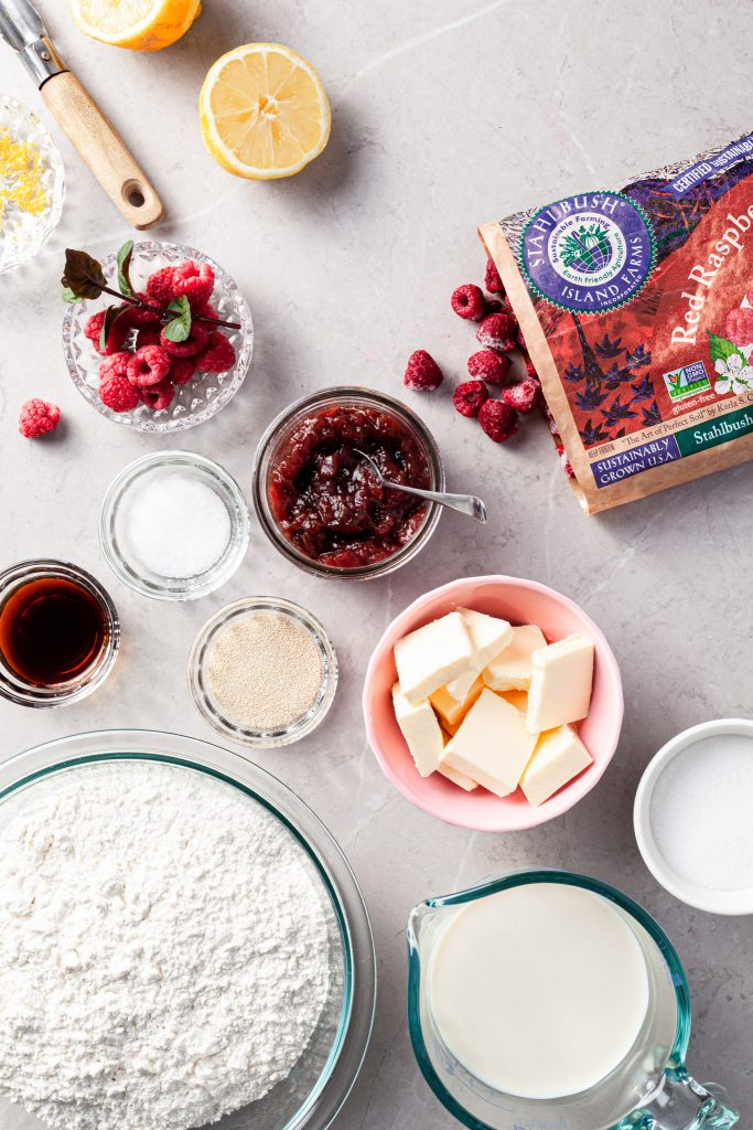 View looking down on a marble counter and the ingredients measured out for the raspberry sweet rolls.